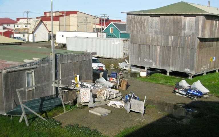 Barrow backyards as viewed from the hotel room window. Miscellaneous Arctic stuff, including a pile of wolf pelts.