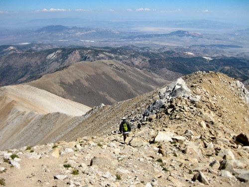 Looking down into Nevada from the summit ridge of Boundary Peak, White Mountains, CA.