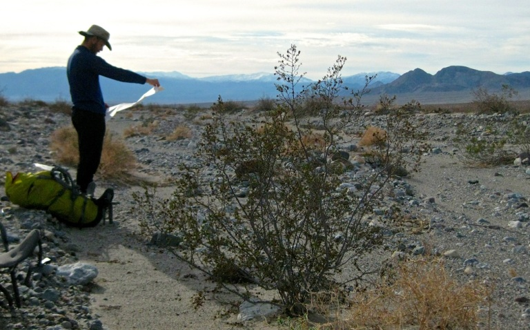 Map check and brief respite from carrying 45-lb packs (mostly water), Death Valley Wash.