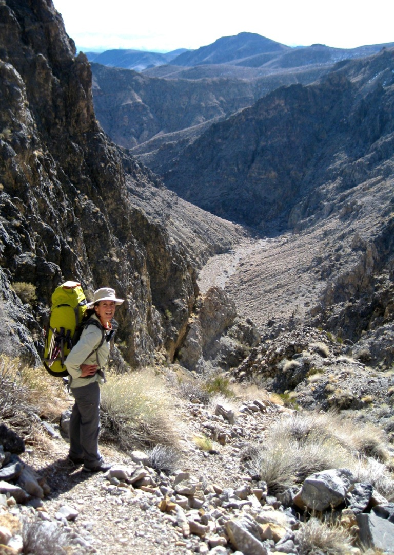 Catching our breath after the 800' gully we had to ascend to get around a 600' series of impassable dry falls. Floor of the canyon is in the background.