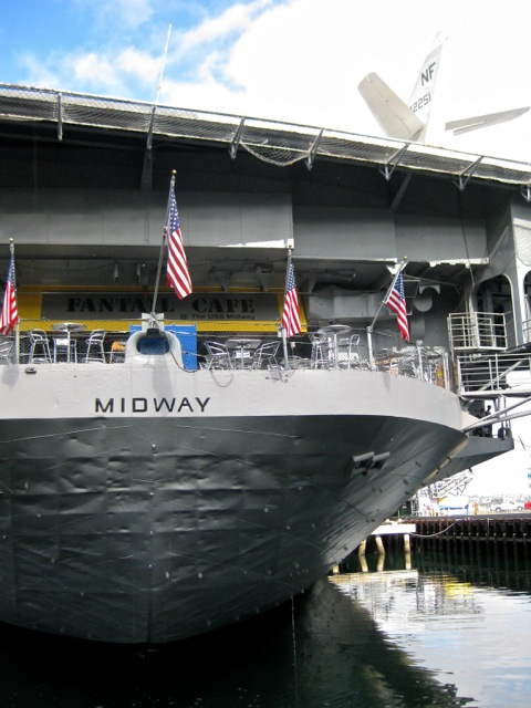 Stern (and café!) of the Midway. Note battered hull.