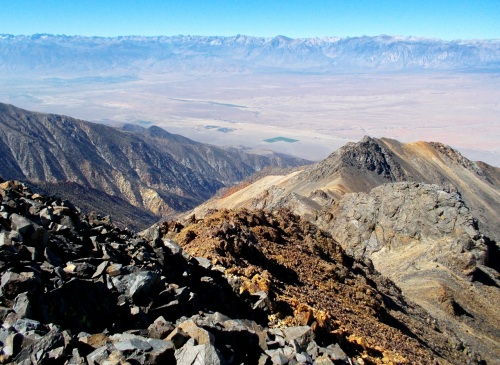 View from the summit southwest toward the Owens Valley floor, Volcanic Tablelands, and Bishop (far left), with the Sierra Nevada beyond.